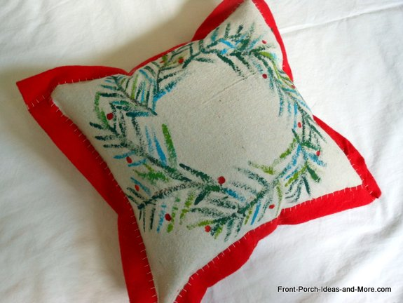 Stitch the 4th side of the wreath pillow to finish it.