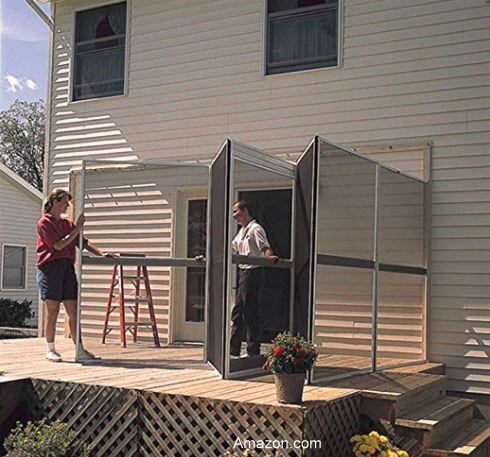 putting up the screened enclosure on the back side of a home