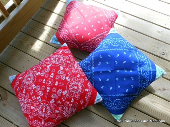 three banadana pillows in red, white and blue