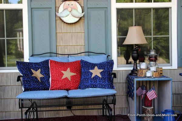 red, white and blue pillow toppers with burlap star in middle