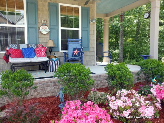 our patriotic porch from further back - see our pretty azaleas
