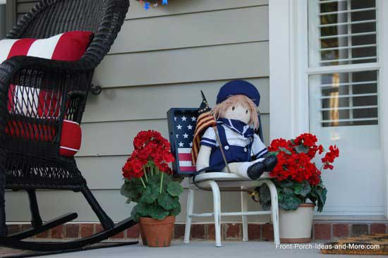 patriotic looking doll on front porch