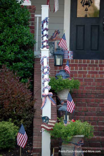 stair railing adorned with flags, ribbons, and patriotic garland