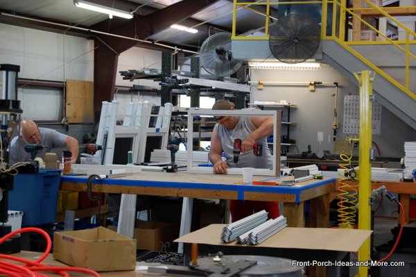 PCA Products employees making handcrafted aluminum screen doors