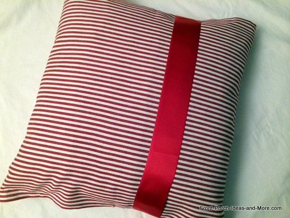 Tea towel pillow decorated with ribbon