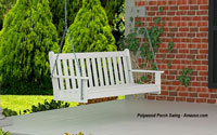 white polywood porch swing on porch
