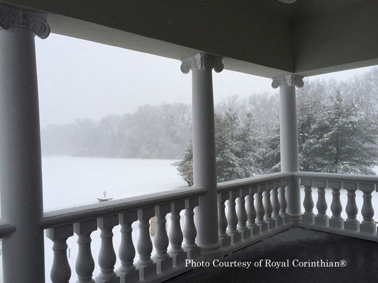 Royal Corinthian® synthetic stone balustrade on porch in winter