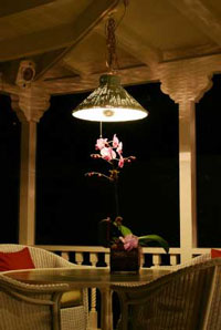 Chandelier over table on porch