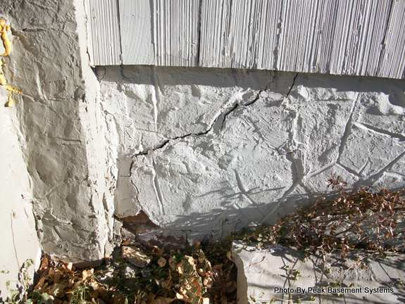 crack in front porch foundation photo by peak basement systems