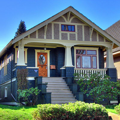 beautiful craftsman style front porch and home