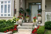 Symmetrical plantings arond front porch