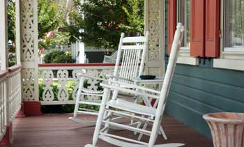 two white rockers on a Victorian style porch