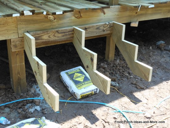 porch stair stringers are cut and fastened to the rim joist