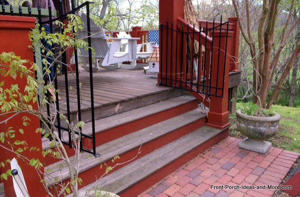 wrought-iron gates on porch steps