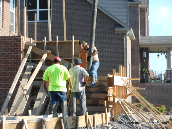 pouring concrete in lower porch step section
