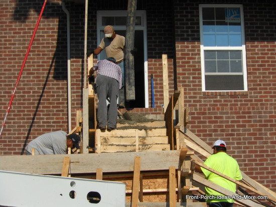 concrete being poured at the top of the steps