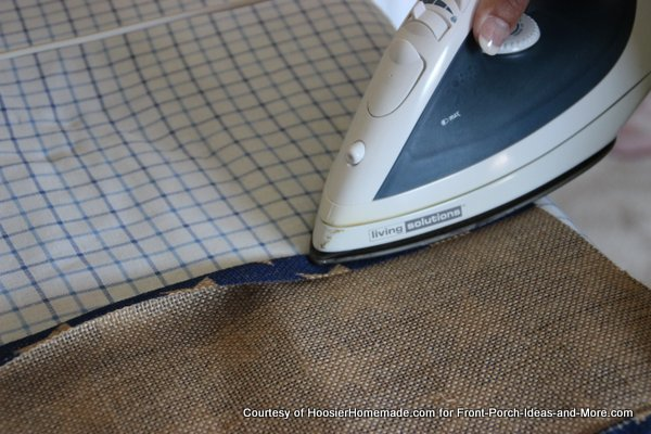 Liz preparing the hems on the sides of the blue burlap