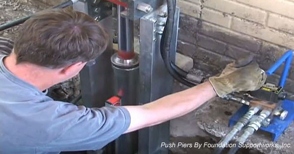 installing push piers by foundation supportworks