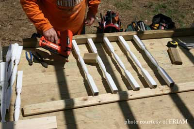 Porch railings being constructed