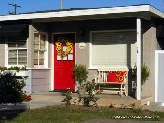 red front door on small front porch