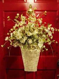 red front door with basket of flowers