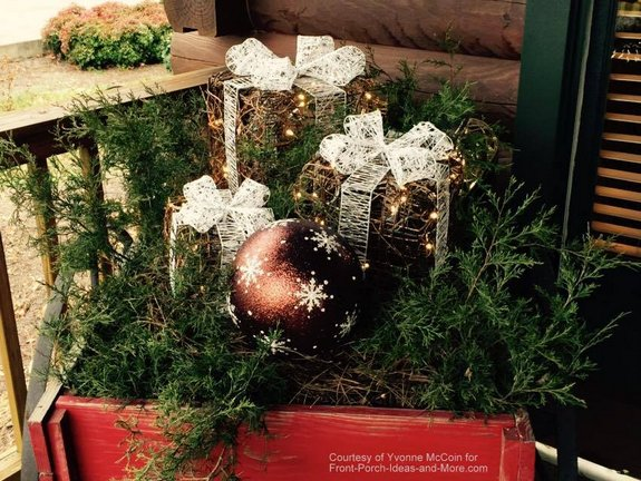 Yvonne's log cabin porch decorated for Christmas - vintage red wagon