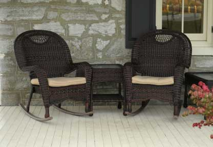 two brown wicker rocking chairs