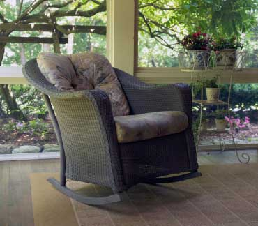 wicker rocking chair with lush cushion