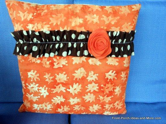 ruffled pillow with felt flower