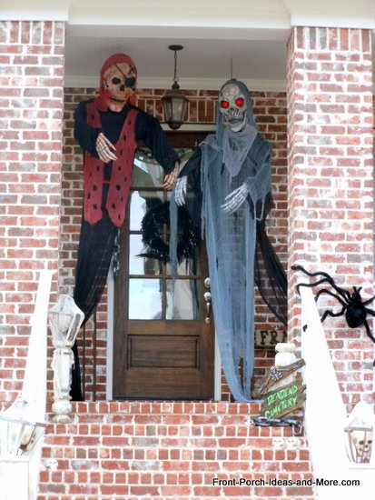 scary halloween decorations - two monsters will greet you on the porch