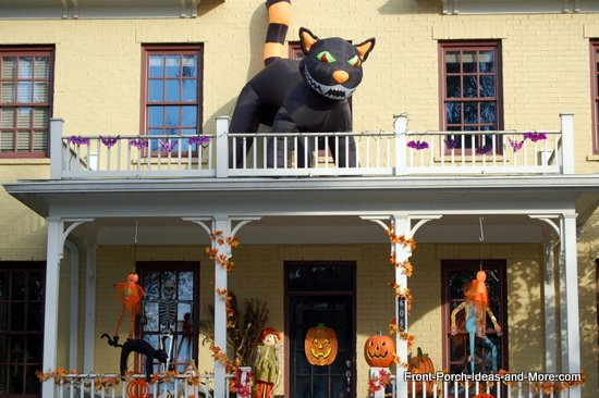 scary halloween decorations - a cute yellow home all decorated for Halloween