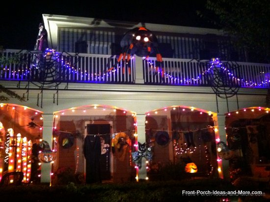 outdoor halloween decorations - the witch's clothes are hanging outside