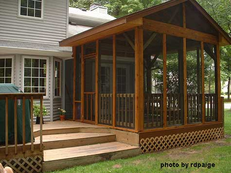 Screen porch addition built on deck surface