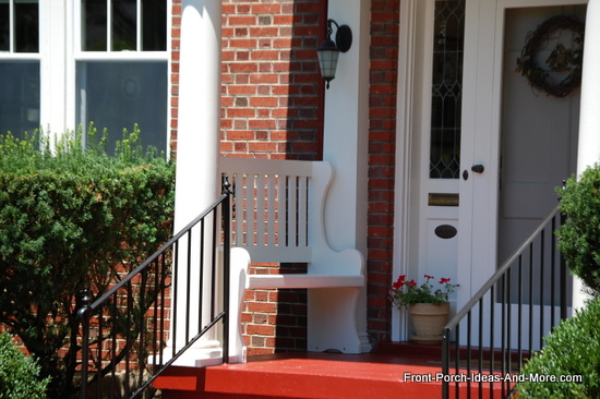 small porch with bench between porch columns