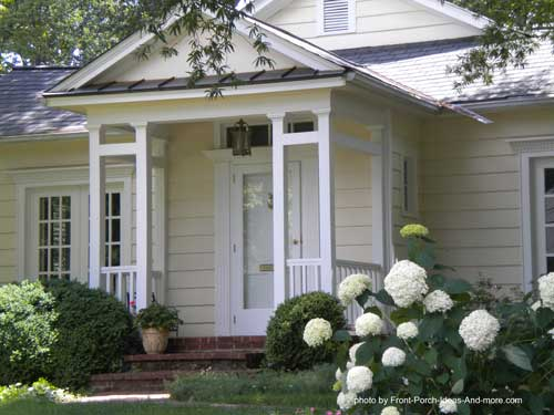 front porch with gable roof and unique front porch columns