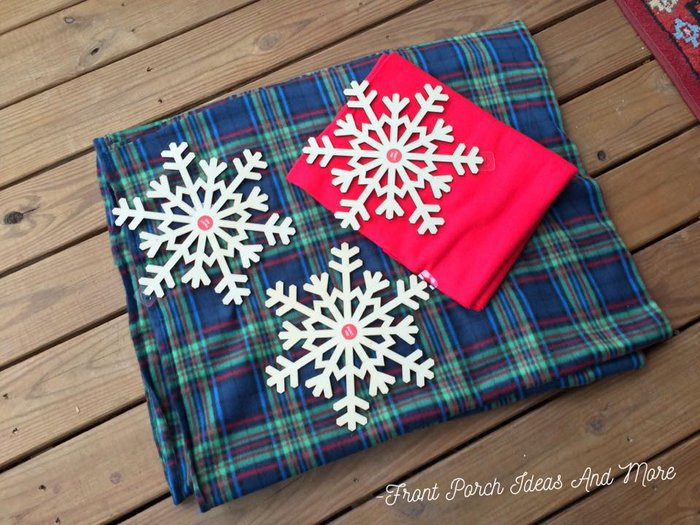 Soft fleece in plaid and red plus a few wooden snowflakes