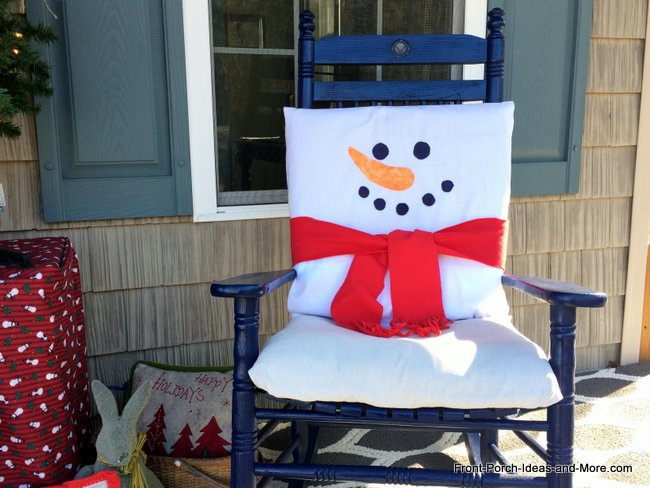 snowman cushion covers on the front porch