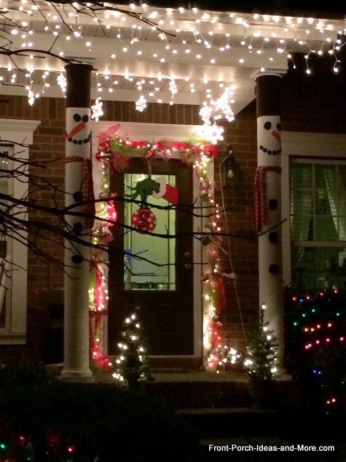 porch columns wrapped as snowmen - so very cute