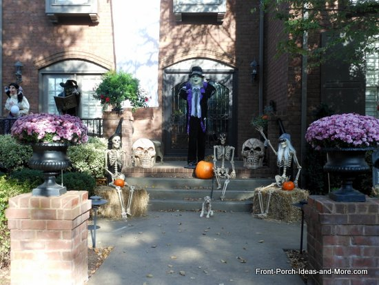 scary halloween decorations - an entire scene of skeletons and dracula-like figures