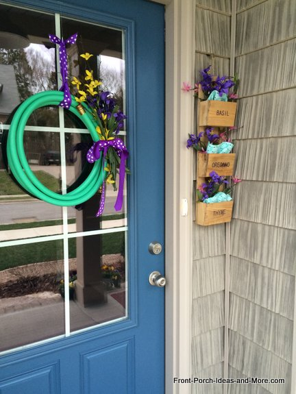Our garden hose wreath is from last year but with new polka dot ribbon and new spring flowers