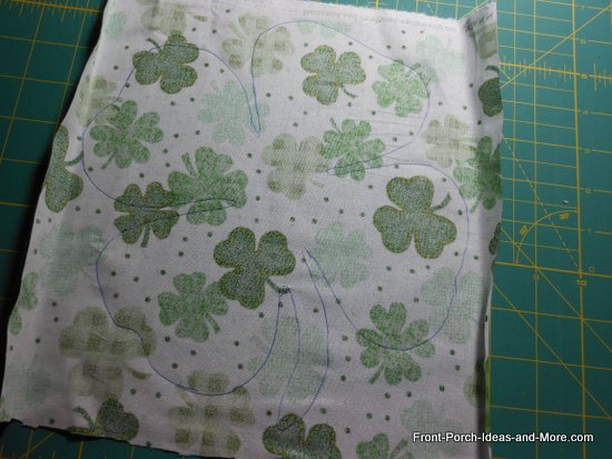 pillow toppers - trace the shamrock onto the back side of your shamrock fabric swatch