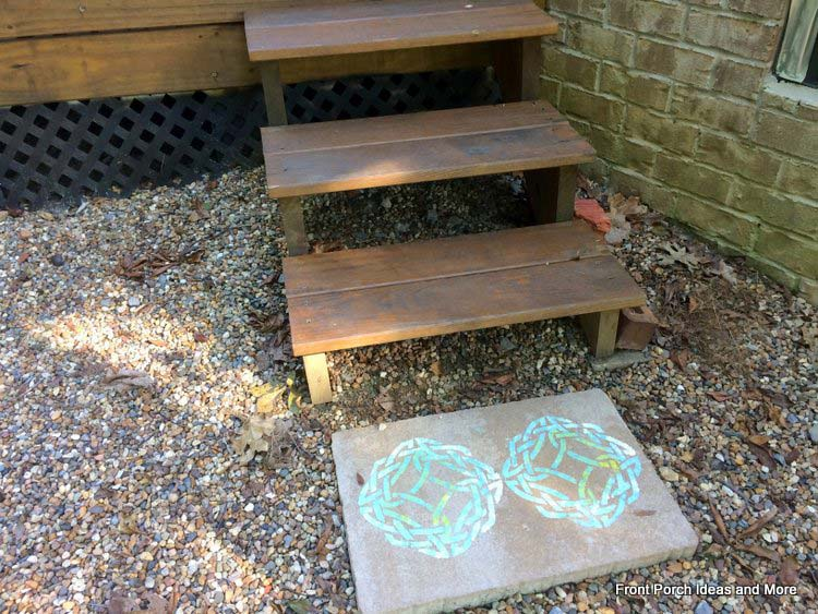 stenciled pavers at the foot of the deck steps