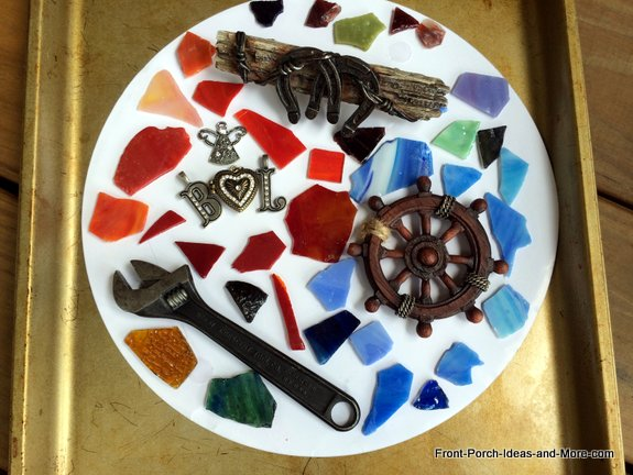 We used the paper liner from the mold as a way to layout the stones and mementos as a rough draft.