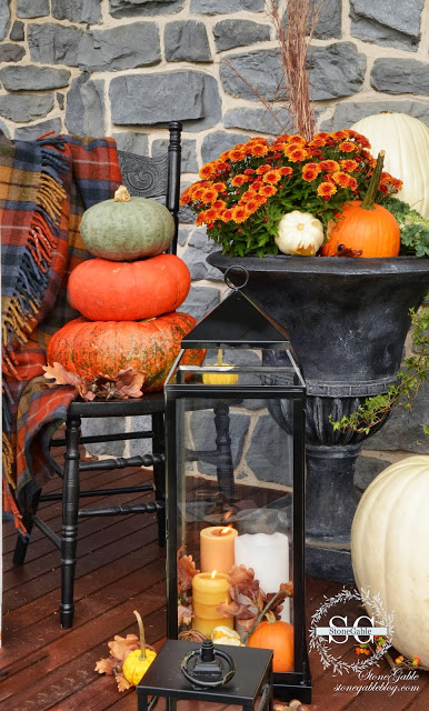 an autumn decorated front porch