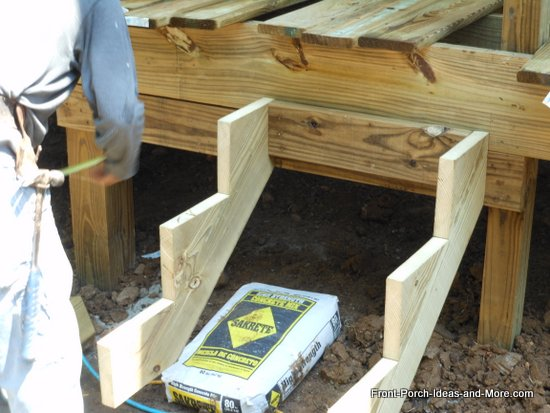 How to build steps how to build a porch porch steps blocking is being added between stringer locations to reinforce the stringers solutioingenieria Image collections