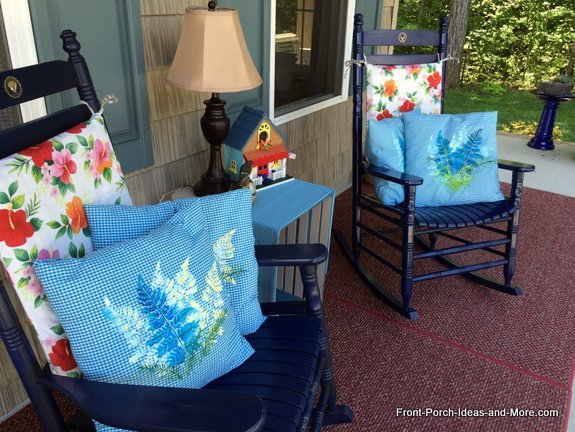 Summer on our porch with bright blue pillow toppers - made by stenciling.