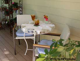 bistro table and chairs on porch