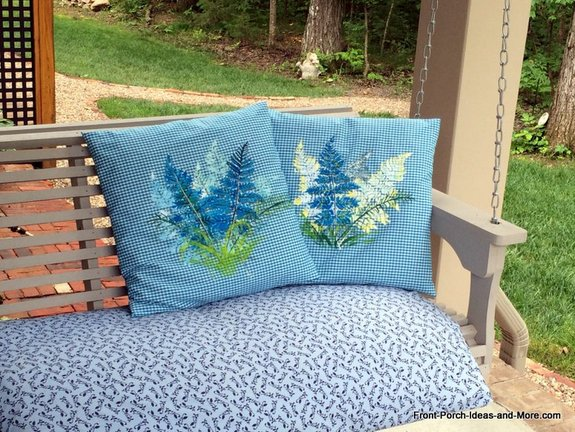 Summer pillow toppers on the porch swing