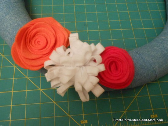 make a loopy flower from white felt