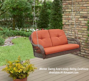 wicker porch swing with terra cotta cushions